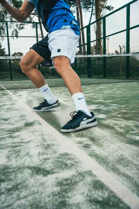 close up photo of man standing on tennis court